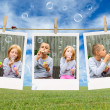 Stock Photo: Brother and sister blowing soap bubbles