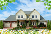 House with flowers — Stock Photo