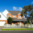 Family home in quiet residential street — Stock Photo #11741704
