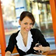 Stock Photo: Cute brunette chatting via cellphone
