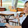 Stock Photo: Woman works having a cup of coffee