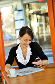 Woman using cellphone at the cafe — Stock Photo
