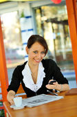 Cute brunette chatting via cellphone — Stock Photo