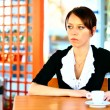Lonely brunette at the cafe thinking about something sad — Stock Photo #12041360