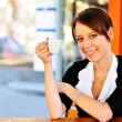 Stock Photo: Cute brunette holding a cup in a hand