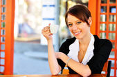 Cute brunette holding a cup in a hand — Stock Photo