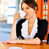 Smiley businesswoman drinking coffee — Stock Photo