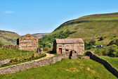 Quaint old stone barns — Stock Photo