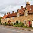 Quaint row of English village houses — Stock Photo