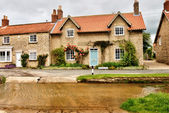 English village with ford. — Stock Photo