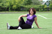 Beautiful Fitness Woman Sitting at Stadium — Stockfoto