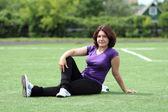 Beautiful Fitness Woman Sitting at Stadium — Stock Photo