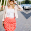 Attractive woman walking on the street — Stock Photo #11406007