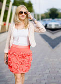 Attractive woman walking on the street — Stock Photo