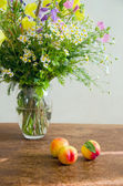 Summer wild flowers with peaches — Stock Photo