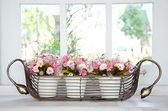 Flower pot in front of a window. — Stock Photo