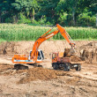 Royalty-Free Stock Photo: Heavy excavator loader at soil moving works.