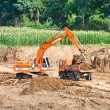 Heavy excavator loader at soil moving works. — Stock Photo