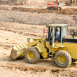 Heavy excavator loader at soil — Stock Photo