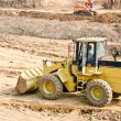 Heavy excavator loader at soil — Stock Photo #12408160