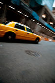 Speeding Yellow City Taxi Cab — Stock Photo