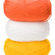 Royalty-Free Stock Photo: Stack of yarn skeins in yellow, orange, white colors on white ba