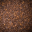 Stock Photo: Numerous coffee beans which have been scattered all over sur
