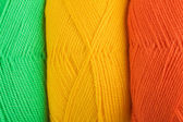 Background of yarn skeins in yellow, orange and green colors — Foto Stock
