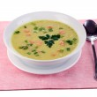 Tasty soup on pink tablecloth isolated on white — Stock Photo