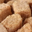 Brown cane sugar cubes background close-up - Stockfoto
