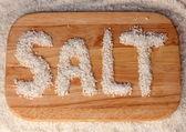 Sea salt on a cutting board close-up — Stock Photo