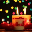 Beautiful candles on wooden table on bright background — Stock Photo #10804971