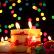 Beautiful candles on wooden table on bright background - Foto Stock