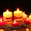 Stock Photo: Beautiful candles and decor on wooden table on black background