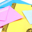 Bunch of color envelopes close-up isolated on white — Stock Photo