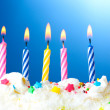 Beautiful birthday candles on blue background — Stock Photo #10808333
