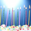 Stock Photo: Beautiful birthday candles on blue background
