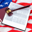 Judge gavel and books on american flag background — Stockfoto