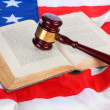 Stock Photo: Judge gavel and book on american flag background
