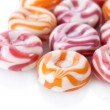 Stock Photo: Striped fruit candies isolated on white