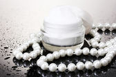 Cosmetic cream on table on grey background — Stock Photo