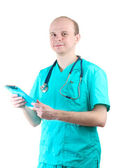 Young doctor man with stethoscope and clipboard isolated on white — Photo