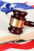 Judge gavel and book on american flag background — Stock Photo