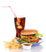 Big and tasty hamburger on plate with cola and fried potatoes isolated on white — Stock Photo