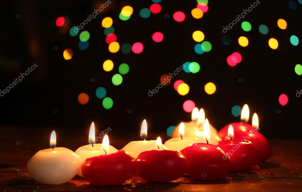 Beautiful candles on wooden table on bright background — Stock Photo #10804994