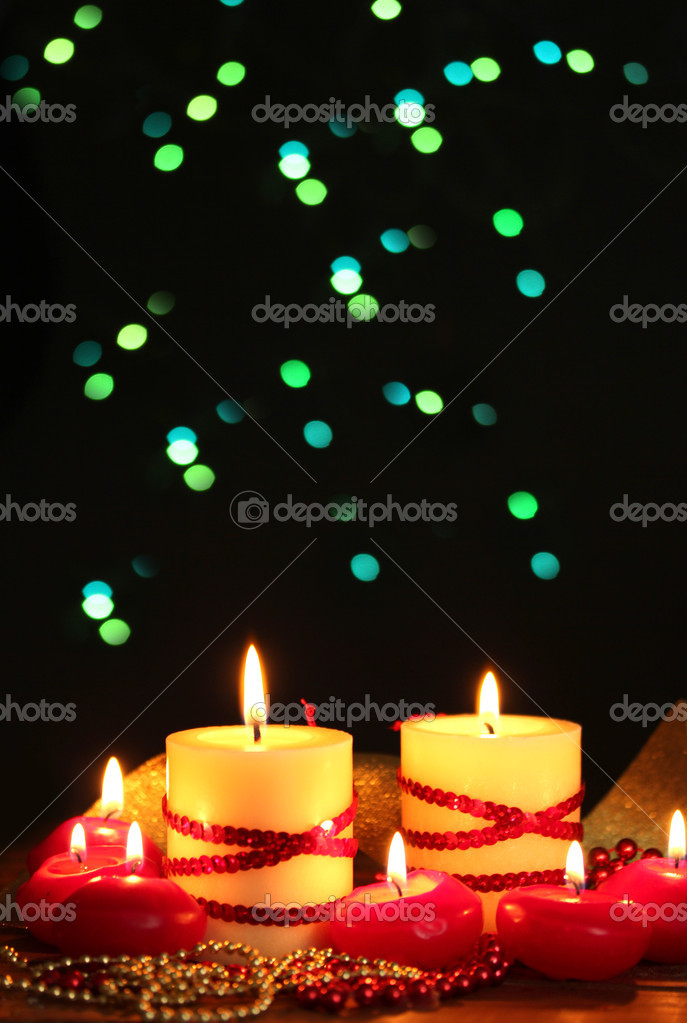 Beautiful candles on wooden table on bright background — Stock Photo #10805007