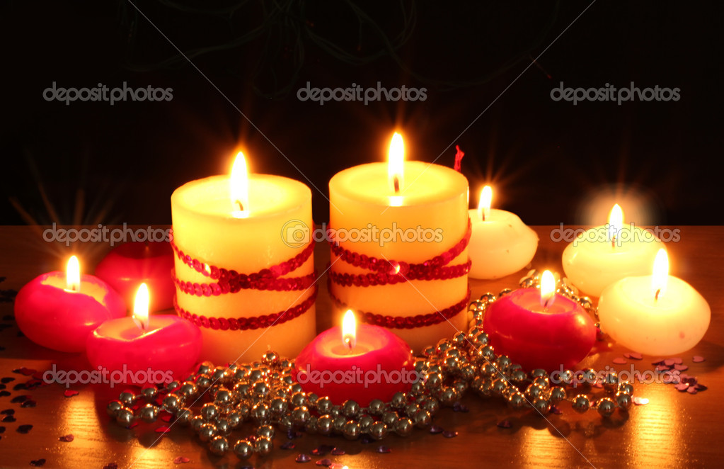 Beautiful candles and decor on wooden table on black background — Stock Photo #10805034
