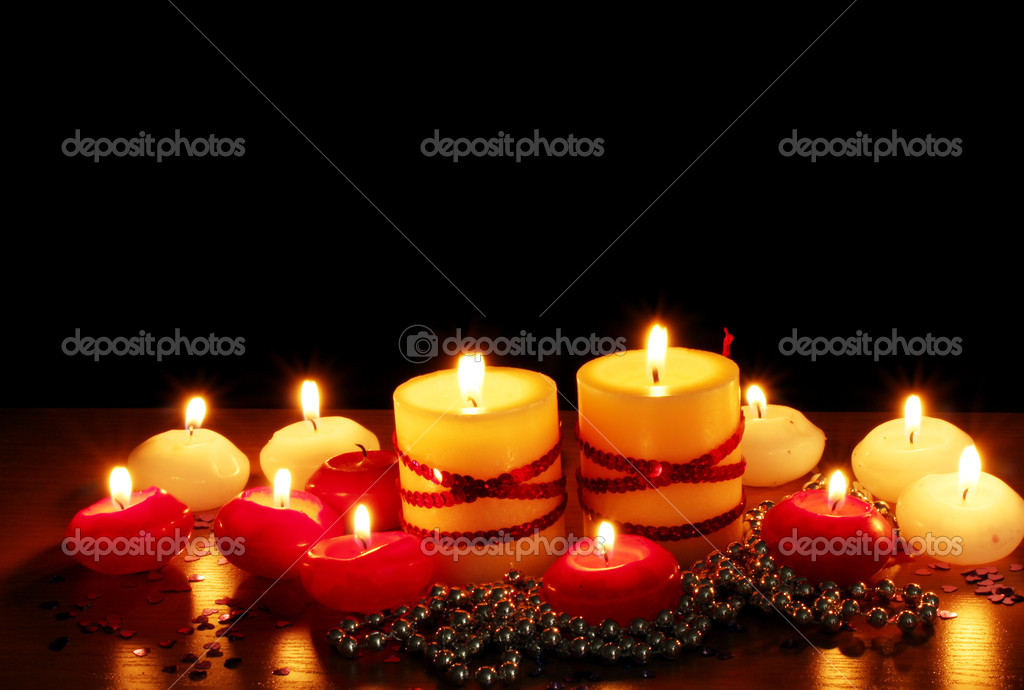 Beautiful candles and decor on wooden table on black background — Stock Photo #10805036