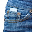 Condom in the pocket of blue jeans on white — Stock Photo #10810203