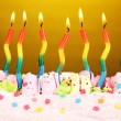 Birthday cake with candles on brown background — Stock Photo